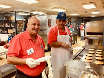 Kiwanis members handle the Pancake Day
