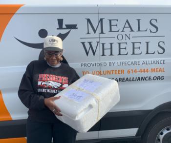 Tara Dyer delivering meals