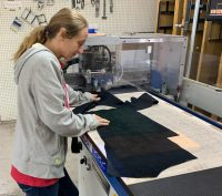 Laying the patterns on the leather begins the process at McKinley Leather