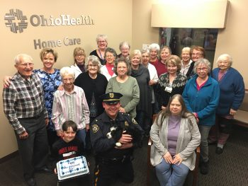 Hospice volunteers gather for a photo on National Law Enforcement Day.