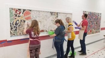 Louise Chell and others working on a mosaic.